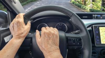 a hand driving a car